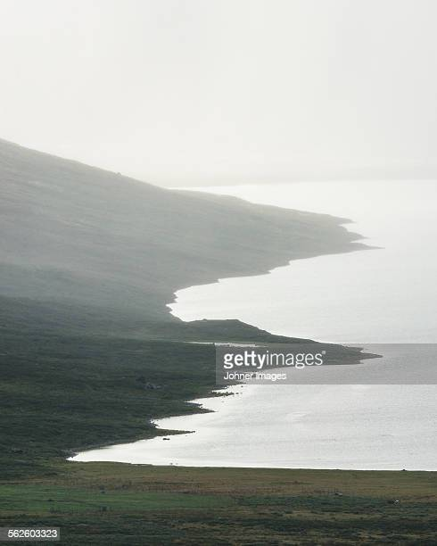 Foggy lake in mountains