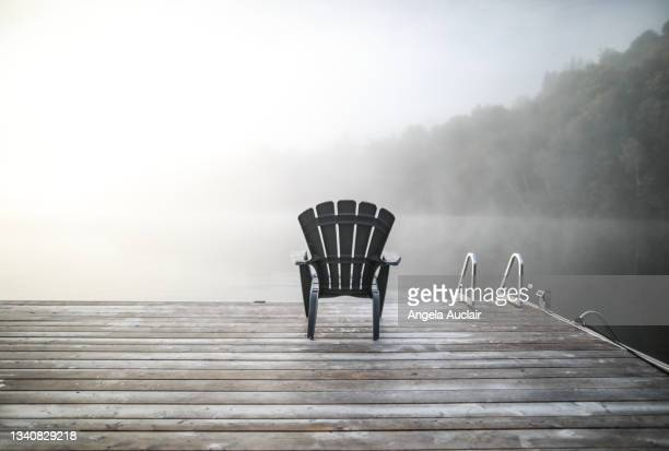 foggy lake morning in laurentians - angela auclair stock pictures, royalty-free photos & images