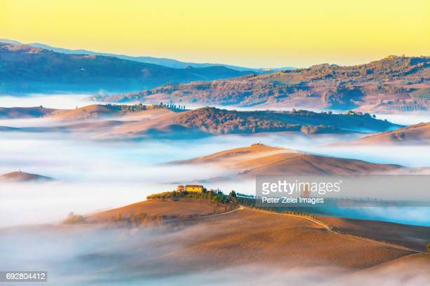 Foggy landscape in Val d'Orcia, Tuscany, Italy