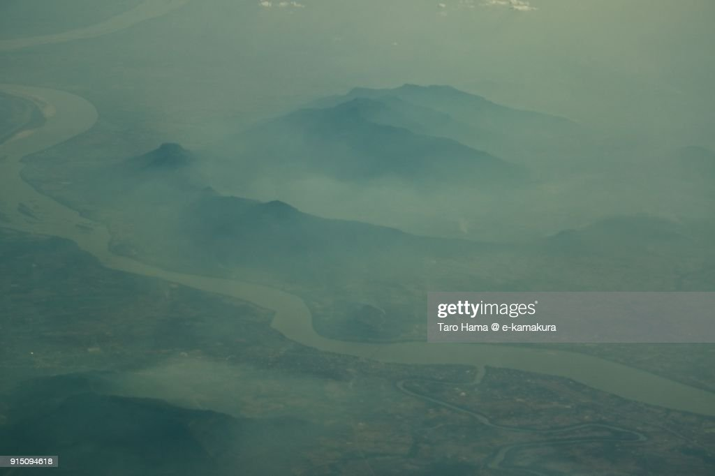 Foggy Mekong River and Pakse in Champasak Province in Laos daytime aerial view from airplane : ストックフォト