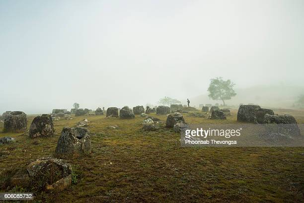 foggy morning at the plain of jars - laos stock pictures, royalty-free photos & images