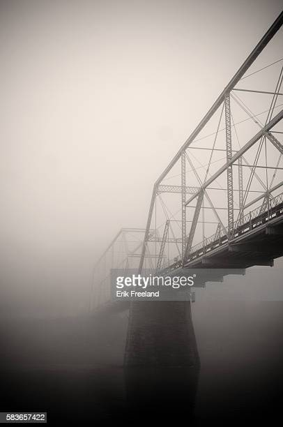 Foggy morning on Skinner's Falls bridge, which connects Sullivan County New York with Wayne County Pennsylvania. The single lane bridge was built in...