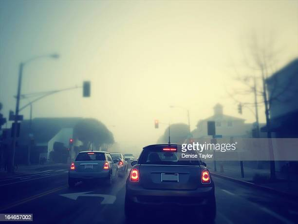 foggy morning on the road - tail light stock pictures, royalty-free photos & images