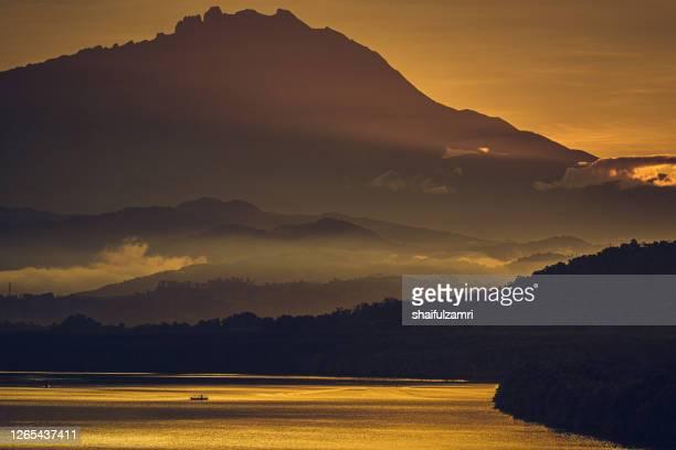 foggy morning over kinabalu national park - shaifulzamri stock pictures, royalty-free photos & images
