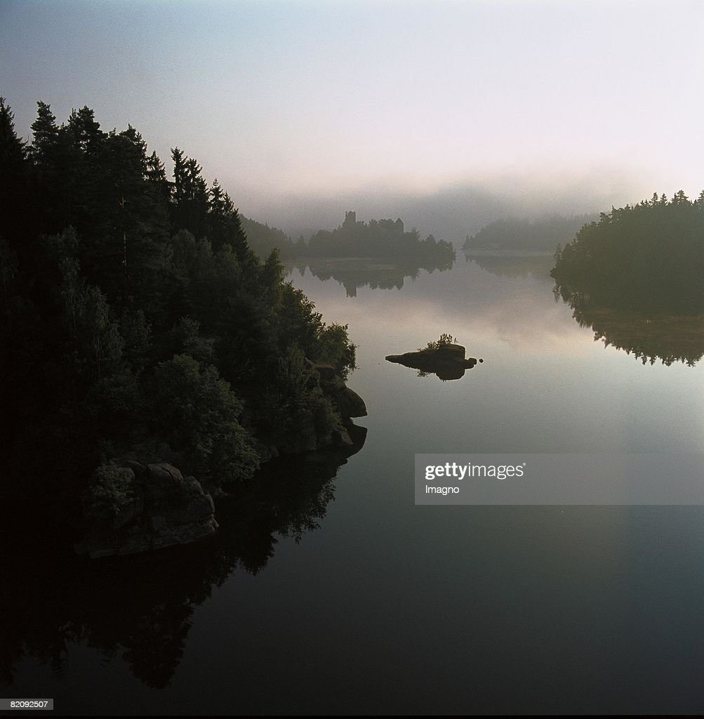 Foggy Ottenstein reservoir of the river Kamp in the Austrian Waldviertel, Silhouette of the Lichtenfels castle ruin in the background, Photograph, Around 2004 : News Photo