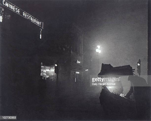 KINGDOM 'A foggy Piccadilly partially lit by the light from a fruit seller's stall' 1952 Foggy London scene 7 December 1952