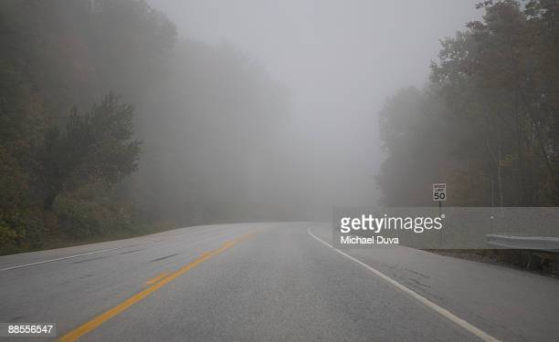 foggy road in countryside - fog stock pictures, royalty-free photos & images