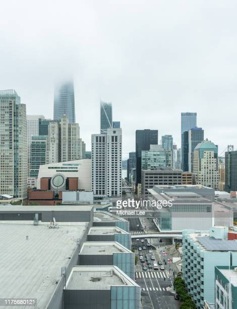 foggy san francisco skyline view from south of market - san francisco financial district stock pictures, royalty-free photos & images