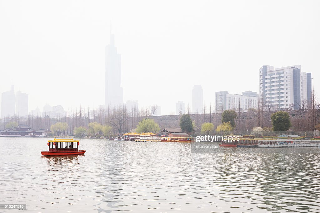 Foggy scene of a boat in the lake : Stock Photo