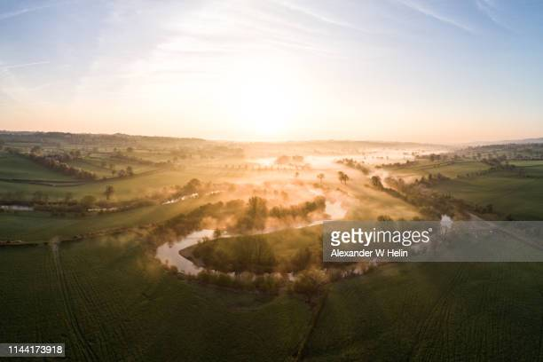 foggy sunrise - morning stock pictures, royalty-free photos & images