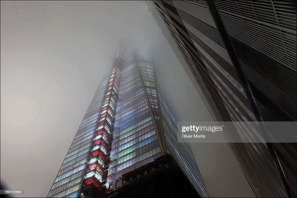 Foggy view of the World Trade Center construction site with Two (left) and One World Trade Center ('Freedom Tower') (right), Lower Manhattan, New York, New York, January 14, 2013.