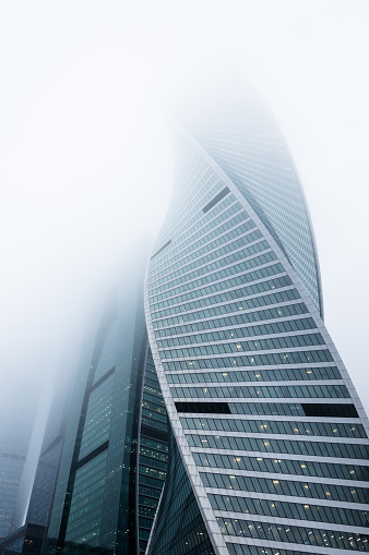 Foggy weather in Moscow, capital city of Russia. Perspective view of the modern skyscrapers outgoing to the foggy sky - gettyimageskorea