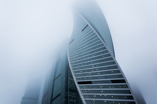 Foggy weather in Moscow, capital city of Russia.Atmosperic photography of the modern skyscrapers outgoing to the foggy sky - gettyimageskorea