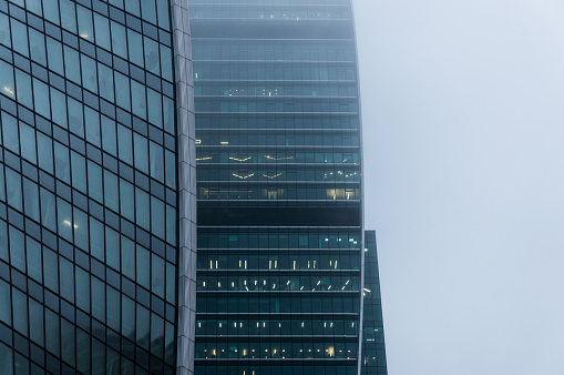 Foggy weather in Moscow, capital city of Russia.Close-up view of the modern skyscraper facade sin the mist - gettyimageskorea