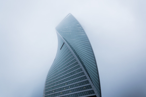 Foggy weather in Moscow, capital city of Russia.Perspective view of the modern skyscraper outgoing to the misty sky - gettyimageskorea