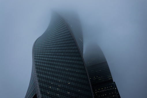 Foggy weather in Moscow, capital city of Russia.Perspective view of the modern glass skyscrapers covered with scotch mist - gettyimageskorea