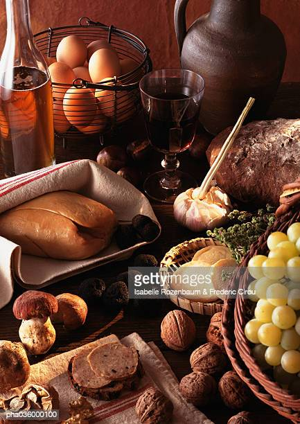 foie gras and truffles displayed on table, surrounded by other foods - foie gras photos et images de collection