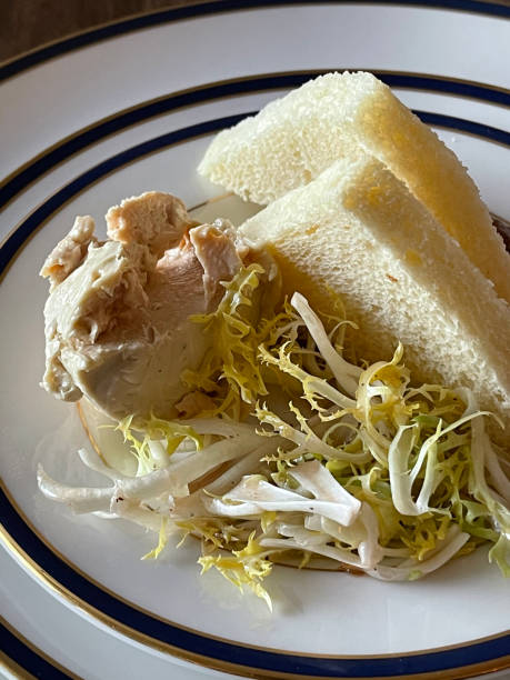 Foie gras served with frisée salad and delicate toast points
