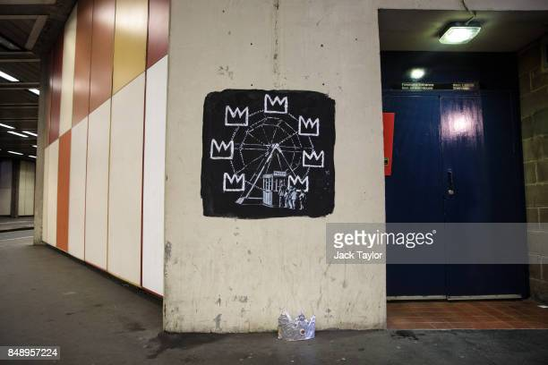 A foil crown sits underneath a new work by street artist Banksy on a wall by the Barbican Centre on September 18 2017 in London England The two new...
