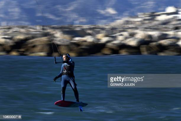 TOPSHOT A foil kitesurfer practices in the Mediterranean Sea off Marseille southern France on January 10 2019
