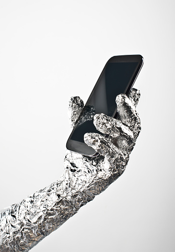 Foil Wrapped Hand And Smartphone - gettyimageskorea