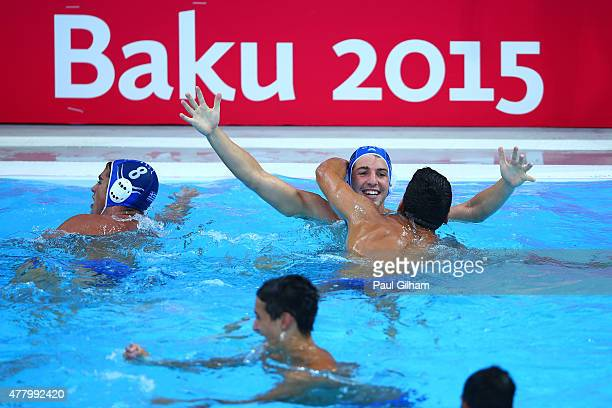 Foivos Kalis of Greece is hugged by a teammate as they celebrate winning the bronze during the Men's Water Polo bronze medal match between Croatia...
