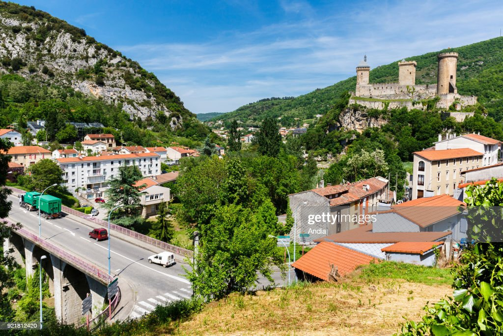 Foix (south-western France), May 2015. Listed as a 'monument historique' (historic monument) since 1840, the fortress dominates the town. In the foreground, the B-road D117 connecting St Girons with Perpignan.