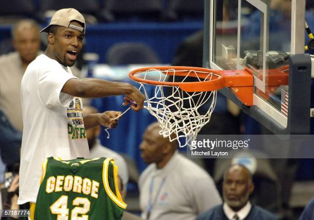 Folarin Campbell of the George Mason Patriots cuts the net in celebration of the victory over the Connecticut Huskies the during the Regional Finals...