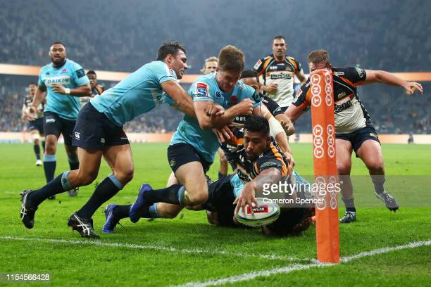 Folau Fainga'a of the Brumbies attempts to score a try in the corner during the round 17 Super Rugby match between the Waratahs and the Brumbies at...