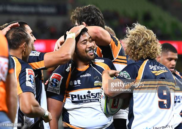 Folau Fainga'a of the Brumbies is congratulated by team mates after scoring a try during the round four Super Rugby match between the Rebels and the...