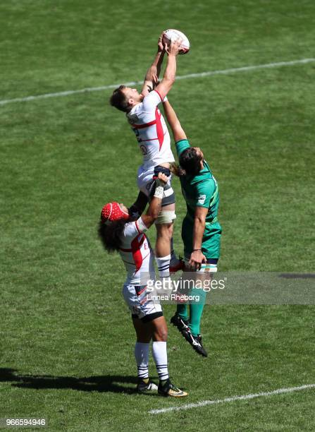 Folau Niua and Ben Pinkelman of United States and Harry McNulty of Ireland in action in their Cup Quarter Final during the HSBC London Sevens at...