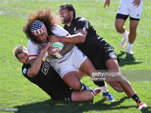Folau Niua of the United States is tackled by Kurt Baker and Sione Molia of New Zealand during the USA Sevens Rugby tournament at Sam Boyd Stadium on...
