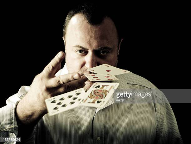 fold - hand of cards stock photos and pictures