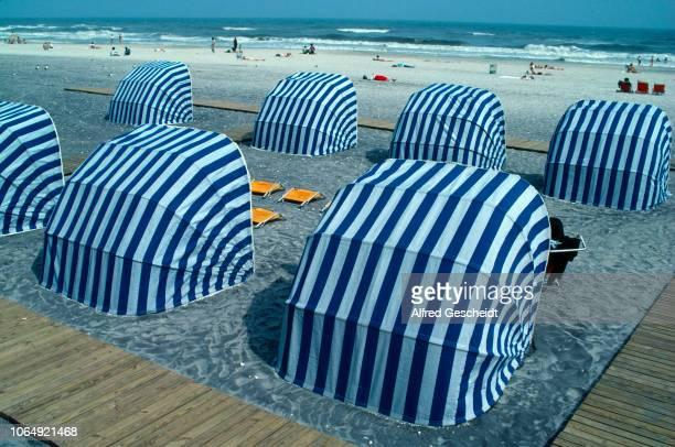 Foldable beach sunshades Boardwalk Atlantic City New Jersey US 1990