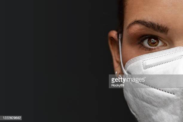 kn95 foldable protective earloop masks for helping to stop the spread of covid-19, coronavirus - single use stock pictures, royalty-free photos & images