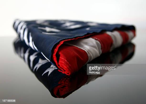 folded american flag - folded stock photos and pictures