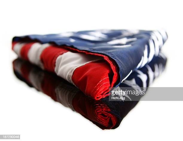 folded american flag - folded flag stock pictures, royalty-free photos & images