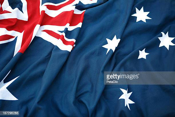 a folded australian flag sitting in hard surface - australian flag stock pictures, royalty-free photos & images