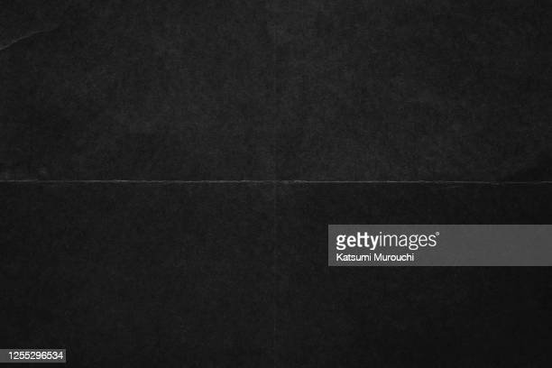 folded black color paper texture background - black colour stock pictures, royalty-free photos & images