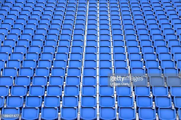 CONTENT] Folded blue plastic chairs in front of Edinburgh Castle during Edinburgh Festival