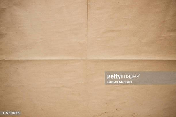 folded brown paper texture background - antiguo fotografías e imágenes de stock