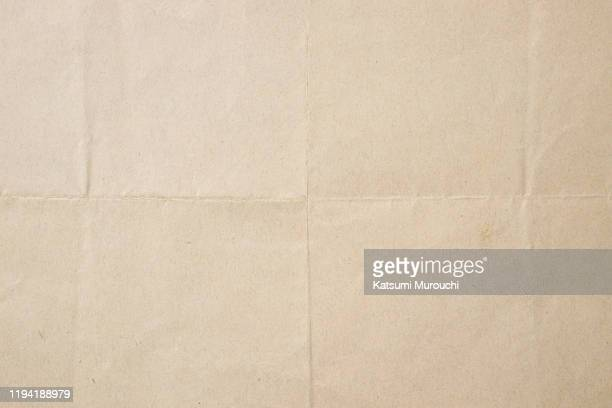 folded brown paper texture background - textured paper stock pictures, royalty-free photos & images