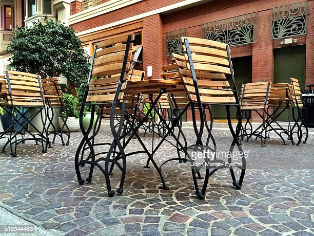 folded chair outside at restaurant - bethesda maryland stock photos and pictures
