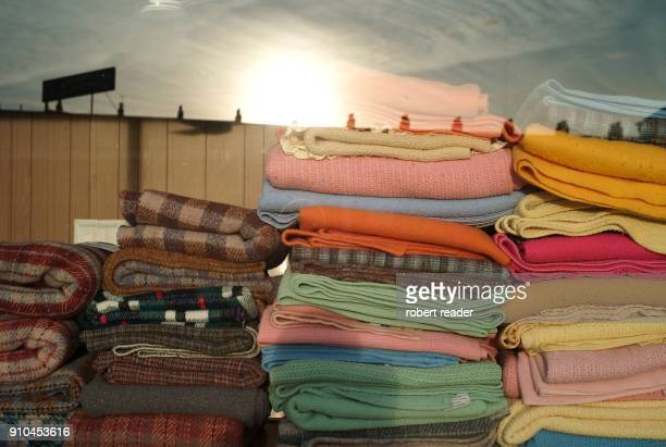 Folded colourful blankets