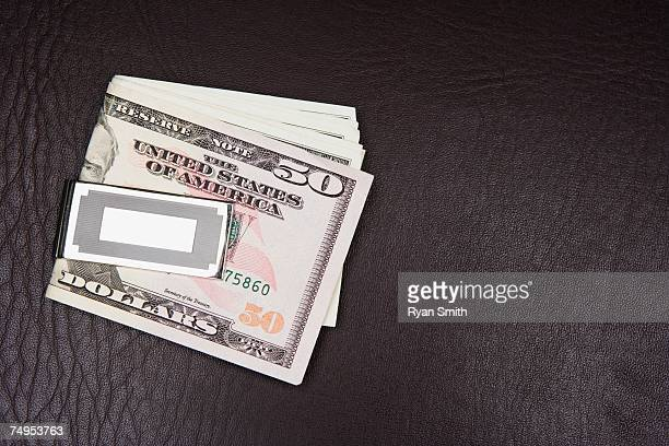 folded dollars in a money clip - greedy smith stock pictures, royalty-free photos & images