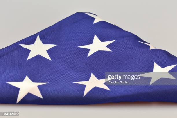 folded flag - folded flag stock pictures, royalty-free photos & images
