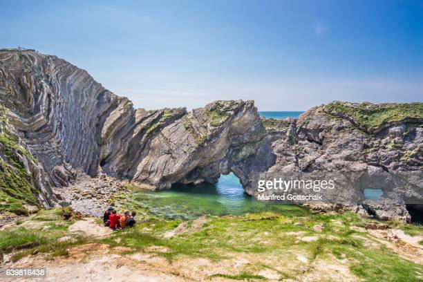 folded limestone strata at stair hole - rock strata stock pictures, royalty-free photos & images