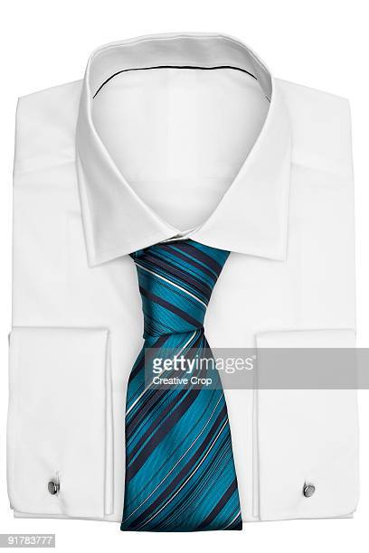Folded men's business shirt with tie