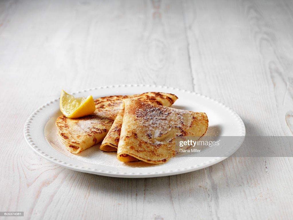 Folded pancakes with sugar and lemon : Stock Photo