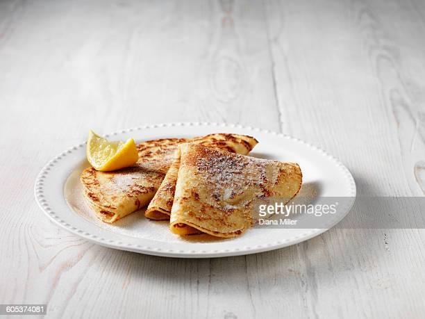 Folded pancakes with sugar and lemon
